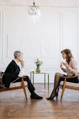 two persons having conversation